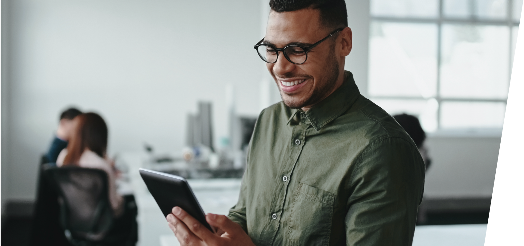Smiling man looking at bank accounts on a tablet
