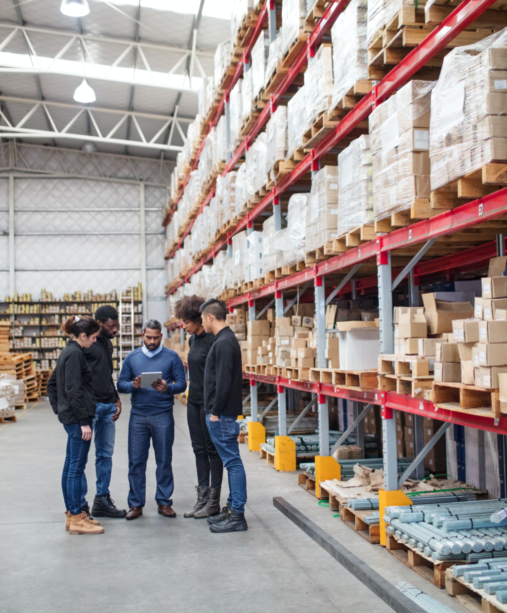 People consulting in a warehouse