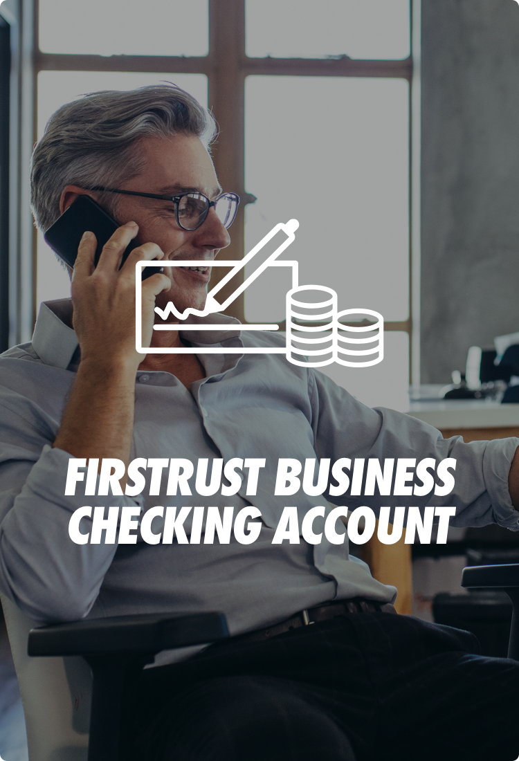 Man in office using phone with business checking account