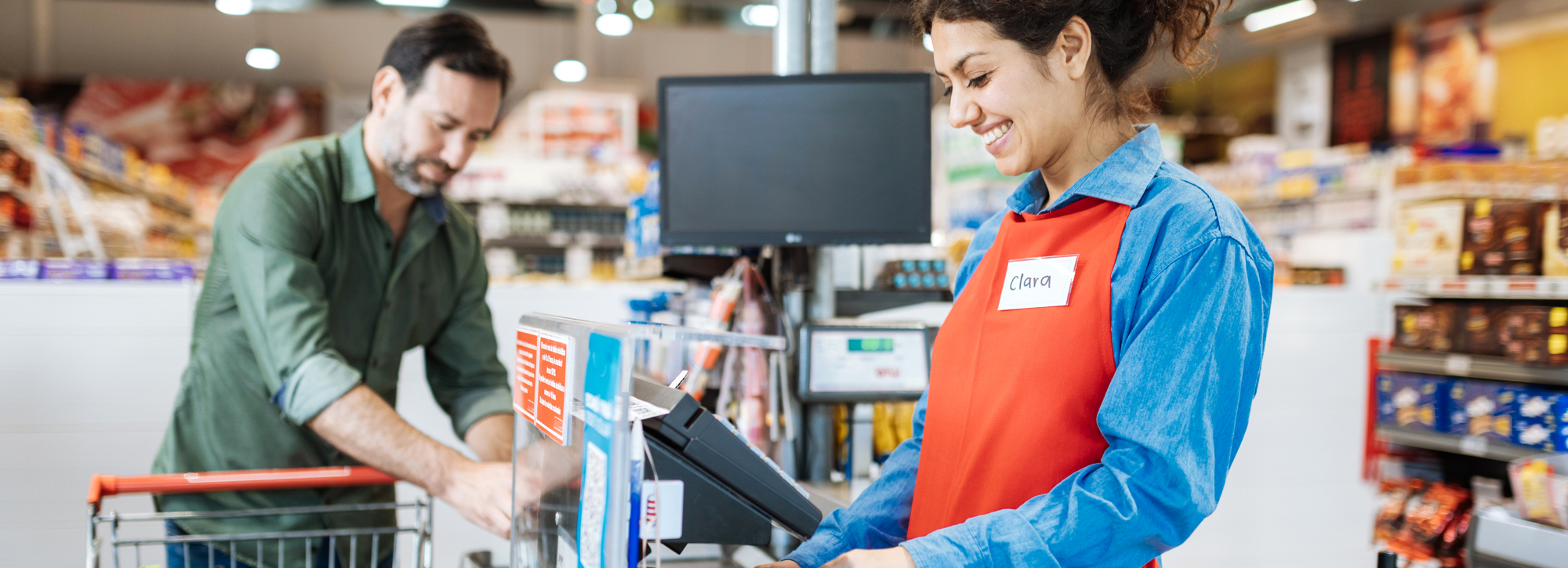 cashier at register with customer